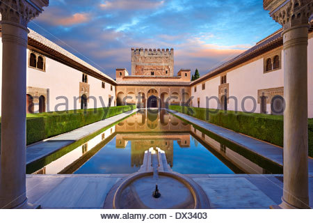 Arabesque Moorish architecture and pond of the Court of the Myrtles of the Palacios Nazaries, Alhambra. Granada, - Stock Photo