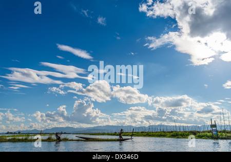 INLE LAKE, MYANMAR - CIRCA DECEMBER 2013: Men working on floating islands in Inle Lake. - Stock Photo