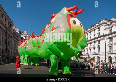 Waterloo Place, London, UK, 16 March 2014 - the annual St. Patrick's Day parade took place in bright sunshine in front of thousands of people who lined the route.  A giant inflatable centipede passes by. Credit:  Stephen Chung/Alamy Live News Stock Photo