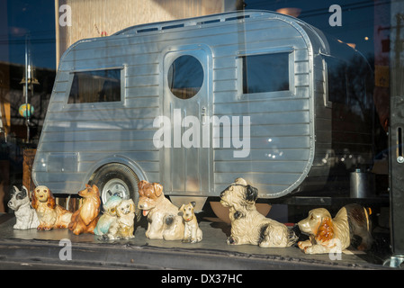 Ceramic dog figurines and trailer. - Stock Photo