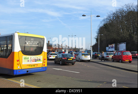 Bus, taxis and private cars crowd in to wait for commuters at the railway station, Hitchin, Hertfordshire, England, - Stock Photo