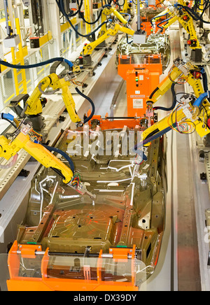 Robots in the underbody sealing and underbody coating station of the paint shop at Chrysler's Sterling Heights Assembly - Stock Photo