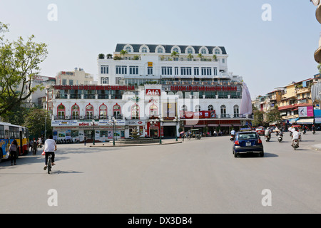 Modern consumer goods, fast food restaurants, cafes and banks begin to encroach on Hanoi's old quarter - Stock Photo