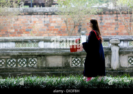 Student graduating from Vietnamese University celebrate at a ceremony held at the Temple of Literature. Hanoi, Vietnam - Stock Photo