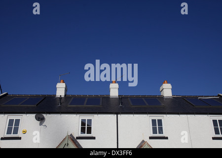 solar panels on a row of terraced houses - Stock Photo