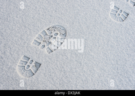 Footprints In Snow - Stock Photo