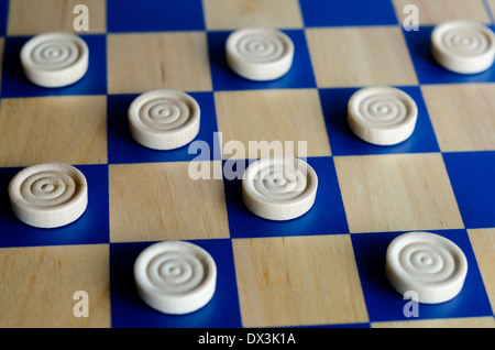 Wooden blue and white checkers game. selective focus close up. Concept photo of business, teamwork, strategy and - Stock Photo