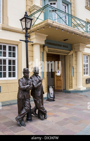 Statue of Stan Laurel and Oliver Hardy outside the Coronation Hall Theatre, Ulverston, Cumbria. - Stock Photo