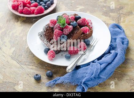 Chocolate cake with summer berries. - Stock Photo