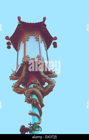 Chinatown ornate Chinese street lamp lantern with dragons, San Francisco, California, United States, toned image, - Stock Photo