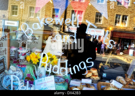 Bakewell tarts and puddings written on a shop window Bakewell Derbyshire England UK - Stock Photo