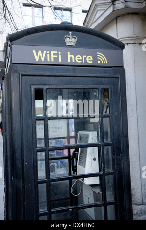 London, England, UK. Repainted traditional telephone box offering WiFi - Stock Photo