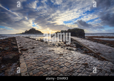 St Michael's Mount in Cornwall captured at sunset from the causeway - Stock Photo