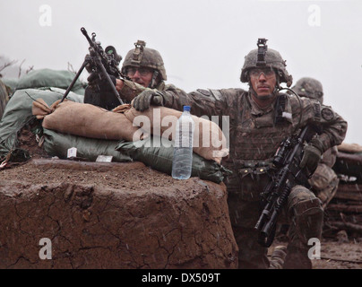 US Army soldiers with the 101st Airborne Division take cover during a firefight March 29, 2011 in the valley of - Stock Photo