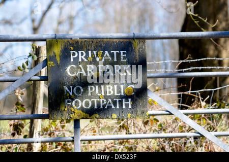 Private Car Park sign - No Public Footpath (Boughton Monchelsea village, Kent, England) - Stock Photo