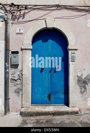 A blue door with mailbox, number 1 and entry phone - Stock Photo