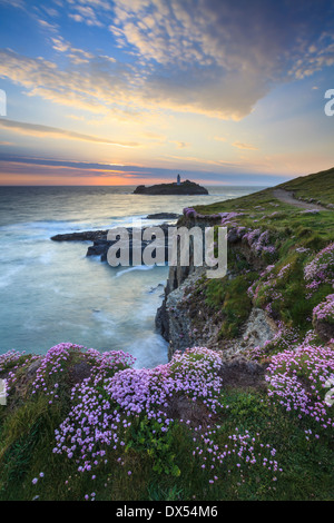 Godrevy Lighthouse captured from near Godrevy Point on an evening in the spring - Stock Photo