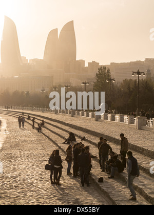 Baku Boulevard at sunset. The boulevard was established in 1909 and today is a popular tourist attraction. - Stock Photo