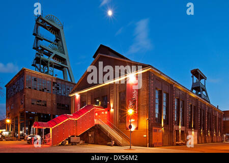 Zeche Ewald colliery with the Revuepalast Ruhr at dusk, Herten, Ruhrgebiet region, North Rhine-Westphalia, Germany - Stock Photo