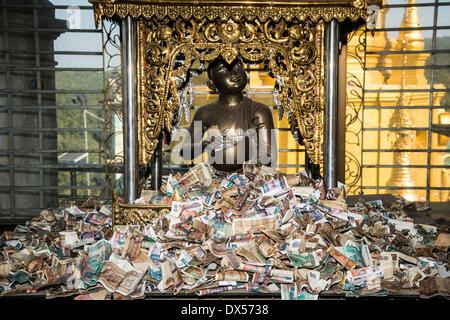 Sculpture and paper money, kyat currency, offerings, Buddhist monastery, Tuyin Taung Pagoda in Bagan, Mandalay Division, - Stock Photo