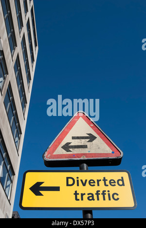 british road signs indicating a two way street ahead and direction for diverted traffic, london, england - Stock Photo