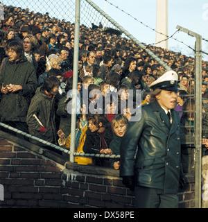 football, Bundesliga, 1973/1974, Ruhr Stadium, VfL Bochum versus FC Schalke 04 2:5, visitors, football fans, policeman, - Stock Photo