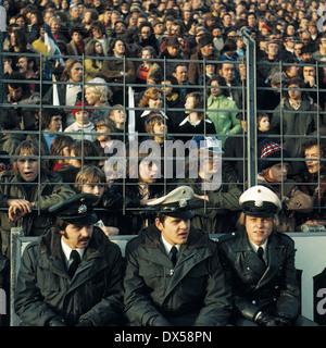 football, Bundesliga, 1973/1974, Ruhr Stadium, VfL Bochum versus FC Schalke 04 2:5, visitors, football fans, policemen, - Stock Photo