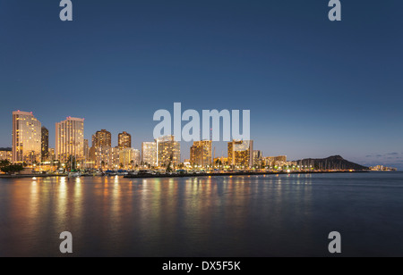 Honolulu skyline from Ala Moana park at night, Hawaii, USA - Stock Photo