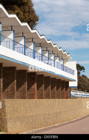 beach huts at Branksome Dene Chine, Poole in March - Stock Photo