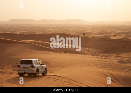 Dubai Desert safari holiday tour  in the Arabian desert with 4X4 cars at sunset, Dubai, UAE, United Arab Emirates, - Stock Photo