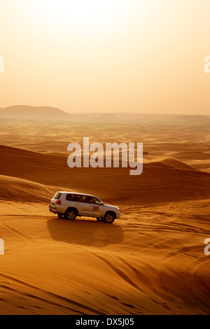 A 4 wheel drive jeep in the Arabian desert, Dubai desert safari, Dubai, UAE, United Arab Emirates, Middle East - Stock Photo