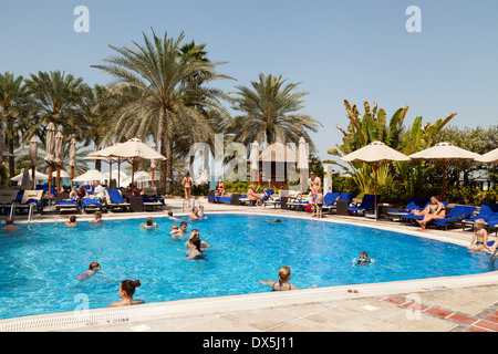 5 star hilton hotel and beach with guests on holiday - Jumeirah beach hotel swimming pool ...
