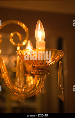 Illuminated crystal wall sconce lights, close up - Stock Photo