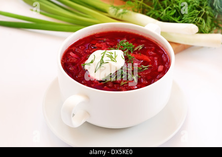 Red borscht soup with dill and sour cream - Stock Photo