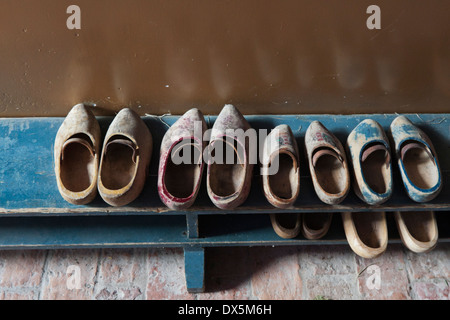 A display of children's wooden shoes in the school at the Zuiderzee Museum, in Enkhuizen, North Holland, The Netherlands. - Stock Photo