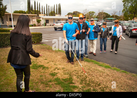 Visitors to a school for the blind in Tustin, CA, are blindfolded to allow them to experience sightlessness as they - Stock Photo