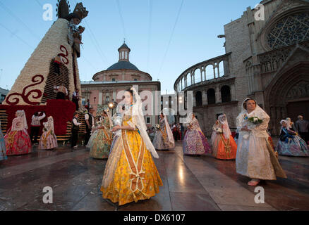 Valencia, Spain. 18th Mar, 2014. Girls in traditional costume are seen during the Fallas Festival Parade to offer - Stock Photo