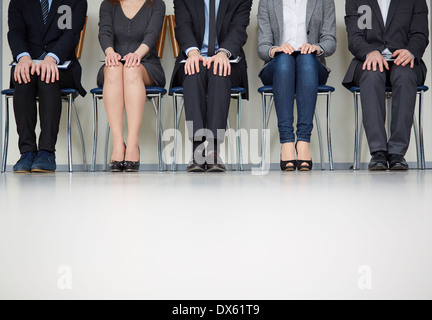Cropped image of people in waiting - Stock Photo