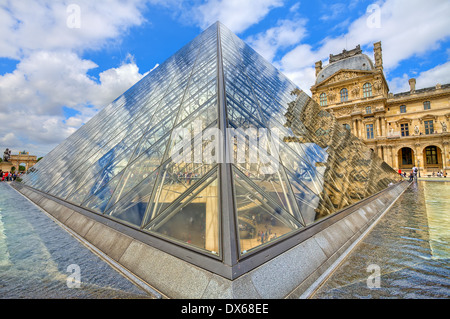 Glass Pyramid of Louvre and Royal Palace in Paris, France. - Stock Photo