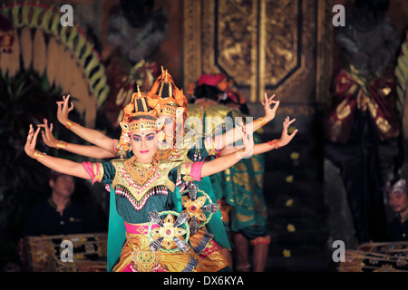 Balinese dancers on stage performing the Legong dance in Ubud, Bali - Stock Photo