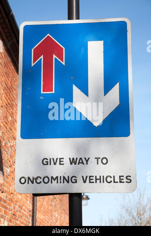 Road sign with arrows Give Way to Oncoming Vehicles, UK - Stock Photo