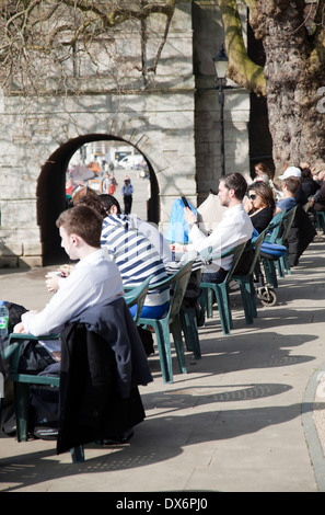 Sitting along promenade by Tide Tables cafe in Richmond TW9 - London UK - Stock Photo