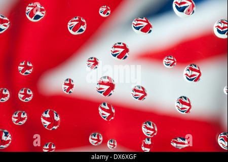 like raindrops water drops in front of a union jack flag bright contrast color - Stock Photo