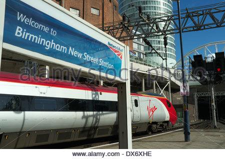 A Virgin train departing Birmingham New Street railway station, West Midlands, UK. - Stock Photo