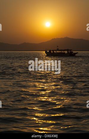 Sunset on the Irrawaddy River, Bagan, Myanmar, (Burma) - Stock Photo