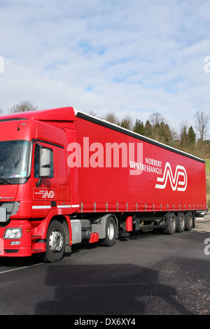 A Norbert Dentressangle truck traveling around a roundabout in Coulsdon, Surrey, England - Stock Photo