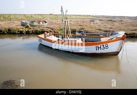 Small fishing boats moored in tidal inlet on the River Alde at Slaughden, Aldeburgh, Suffolk, England - Stock Photo