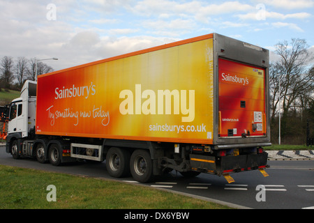 An articulated truck entering a roundabout in Coulsdon, Surrey, England - Stock Photo