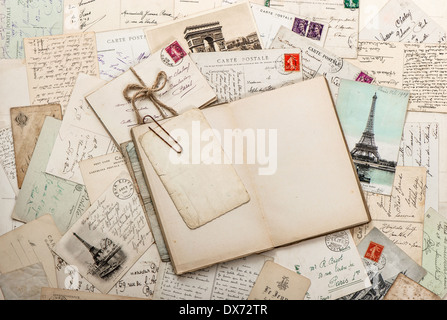 open empty diary book, old letters, french postcards. nostalgic vintage scrapbook background - Stock Photo