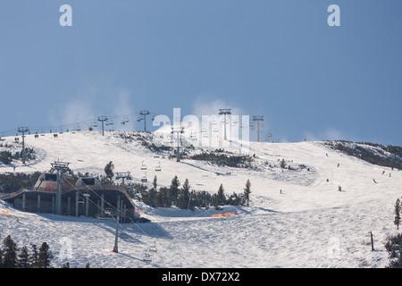 Downhill skiing on Todorka mountain, Bansko, Bulgaria - Stock Photo